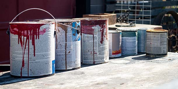 Used paint tins, fuels and solvents.